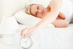 Upset blonde woman waking up Royalty Free Stock Photos