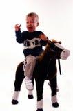 Upset Boy. A boy on his riding horse crying royalty free stock photos