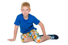 Upset boy in the blue shirt Royalty Free Stock Image