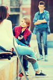 Upset boy and couple of teens apart on the street Royalty Free Stock Photography