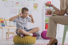 Upset boy covering ears Royalty Free Stock Photos