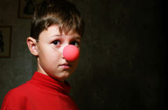 Upset boy in dark room Royalty Free Stock Photo