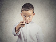 Upset boy giving figa gesture with hand. Closeup portrait serious, unhappy child, boy with Hand in Figa mudra isolated grey wall background. Negative human royalty free stock images