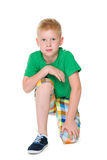 Upset boy in the green shirt Stock Photo