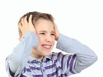 Upset boy , holding his hands behind his head isolated on white Stock Photos