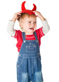 Upset boy in a red cap with horns is crying Royalty Free Stock Photos