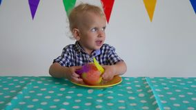 Upset boy son dont eat apple and throw it away. Gimbal motion. Upset boy son dont eat apple and throw it away. Mother hand give child apple. Gimbal motion shot stock video
