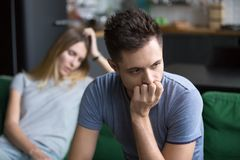 Upset boyfriend thinking of family conflicts after fight with gi. Upset frustrated boyfriend thinking of family conflicts after fight with girlfriend, sad stock image