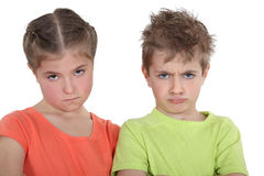 Upset brother and sister. Upset little brother and sister Royalty Free Stock Photo