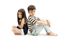 Upset brother and sister together Royalty Free Stock Photography