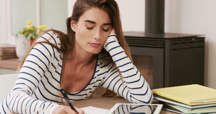 Upset brunette paying bills. At home stock footage