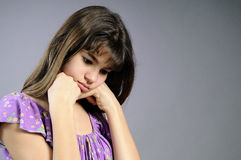 Upset Brunette Thinking To Her Friends Royalty Free Stock Photo