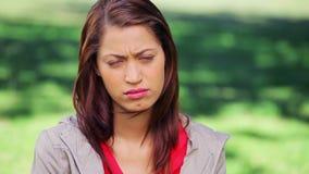 Upset brunette woman standing upright stock video footage