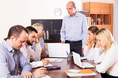 Upset business team in office Royalty Free Stock Photos