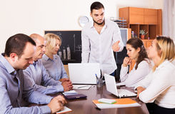 Upset business team in office Stock Image