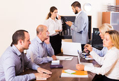 Upset business team in office Royalty Free Stock Images