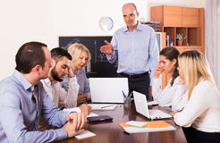 Upset business team in office Stock Photo