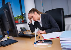Upset business woman. In office looking at computer Stock Photography