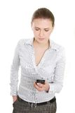 Upset business woman with cell phone Stock Image