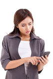 Upset business woman using, texting with smartphone Royalty Free Stock Photo