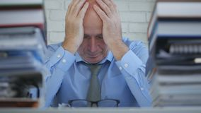 Upset Businessman With Desperate Hand Gesture Feeling Tired In Office Room royalty free stock image