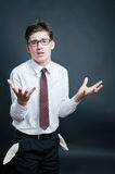 Upset businessman with empty pockets Stock Photography