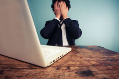 Upset businessman at laptop Stock Photo