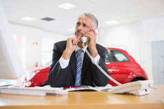 Upset businessman making a phone call Royalty Free Stock Images