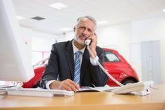 Upset businessman making a phone call Stock Image