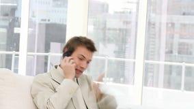 Upset businessman on phone stock video footage