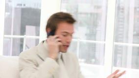 Upset businessman on phone stock video