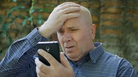 Upset Businessman Read Bad News on Tablet and Make Nervous Hand Gestures stock image