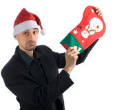 Upset businessman in a Santa hat Royalty Free Stock Photography