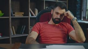 Upset businessman sitting in office at evening. Sad businessman thinking. Upset businessman sitting in chair in office at evening. Disappointed man thinking stock video