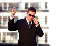 Upset businessman talking over the phone Stock Photo