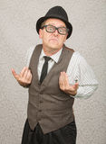 Upset Businessman. Upset white businessman with hat and eyeglasses royalty free stock photography