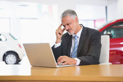 Upset businessman working on computer Royalty Free Stock Image