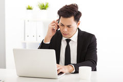 Upset businessman working in the  office Stock Photos