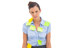 Upset businesswoman with adhesive notes Stock Image