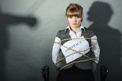 Upset businesswoman bound by contract terms. Stock Images