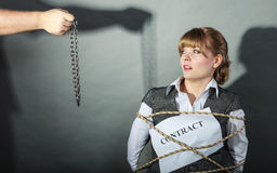 Upset businesswoman bound by contract terms. Stock Photo
