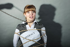 Upset businesswoman bound by contract terms. Stock Photos