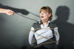 Upset businesswoman bound by contract terms. Stock Image