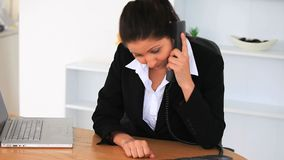Upset businesswoman with a laptop and a phone. In an office stock footage