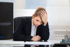 Upset businesswoman in office Royalty Free Stock Photo
