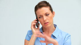 Upset businesswoman on the phone. Against white background stock footage