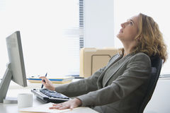 Upset Businesswoman Working in Office Royalty Free Stock Image