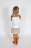 Upset child. Child has back turned and arms crossed. We are looking at the back of a child Royalty Free Stock Images