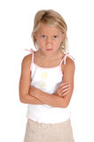Upset Child. Child stands with questionable look on her face and Crossed arms. She is mad and does not understand Stock Photography