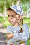 Upset child. Upset little girl. A child on a walk Stock Photo